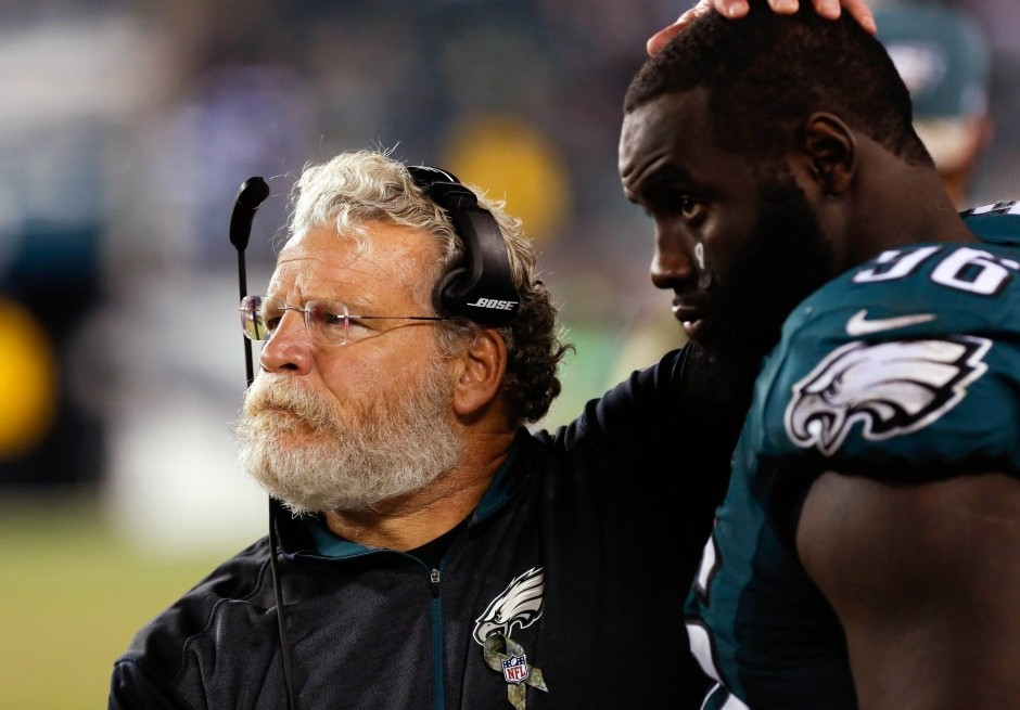 Jerry Azzinaro and nose tackle Bennie Logan - USA Today