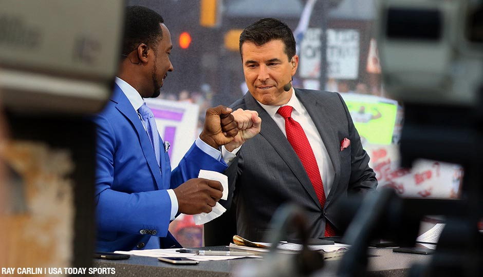 Desmond Howard and Rece Davis fist bump moments before the live broadcast of ESPN College GameDay at Sundance Square.