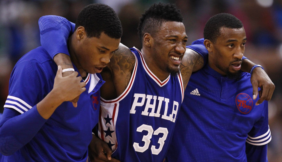Sixers forward Robert Covington is helped off the floor after suffering a right knee sprain in Friday's preseason finale against the Celtics | Mark L. Baer-USA TODAY Sports