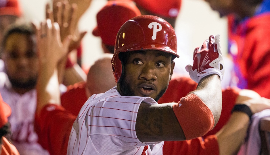 Philadelphia Phillies right fielder Domonic Brown (9) high fives team mates in the dugout after hitting a three RBI home run during the third inning against the New York Mets at Citizens Bank Park. | Bill Streicher-USA TODAY Sports