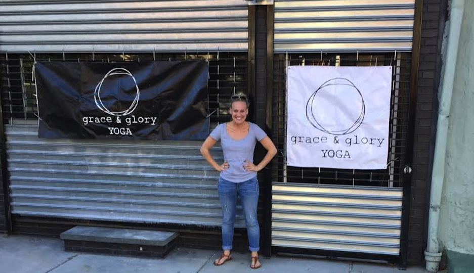 Brittany Everett standing in front of the new Grace and Glory Yoga studio.