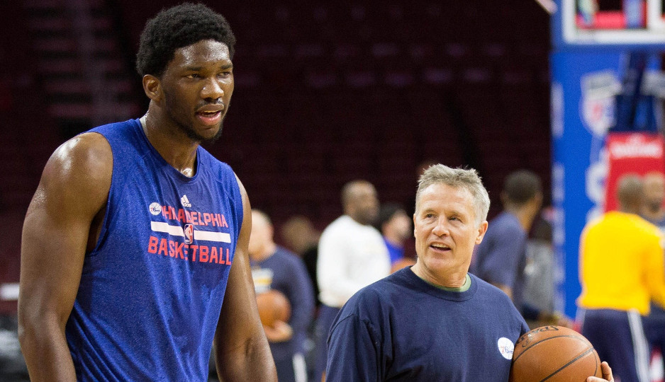 Sixers head coach Brett Brown works with Joel Embiid before the Sixers played the Indiana Pacers last season at the Wells Fargo Center | Bill Streicher-USA TODAY Sports