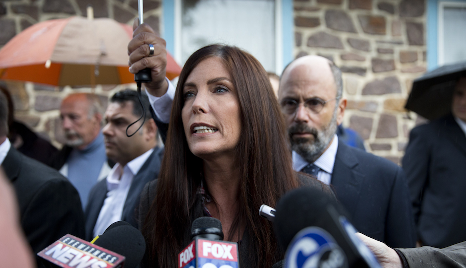 Pennsylvania Attorney General Kathleen Kane speaks with members of the media after her arrangement before a district judge, Thursday, Oct. 1, 2015, in Collegeville, Pa. Prosecutors added a new perjury count and other criminal charges Thursday against Kane, saying they found a signed document that contradicts her claims she never agreed to maintain secrecy of a grand jury investigation in 2009, before she took office. The Montgomery County district attorney charged her with felony perjury and two misdemeanors — false swearing and obstruction — based on a signed secrecy oath she signed shortly after taking office in early 2013. AP Photo/Matt Rourke)
