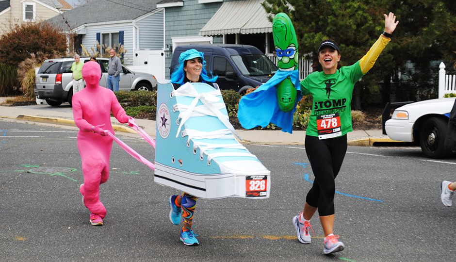 Runner Andi Sawin, pictured here as the sneaker, and her friend, Carolyn Stellatella, the bubble gum and also creator of both costumes in full.