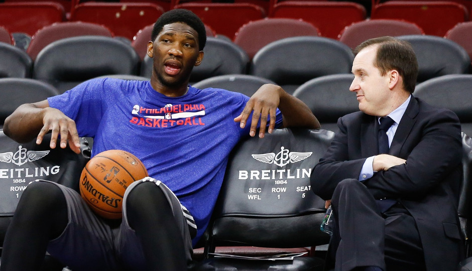 Sixers general manager Sam Hinkie talks with Joel Embiid before a game last season | Bill Streicher-USA TODAY Sports