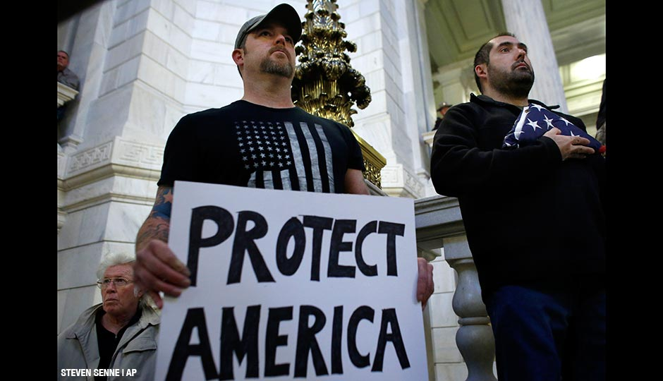 Veterans during a rally Thursday, Nov. 19, 2015, at the Statehouse, in Providence, R.I., held to demonstrate against allowing Syrian refugees to enter Rhode Island following the terror attacks in Paris.