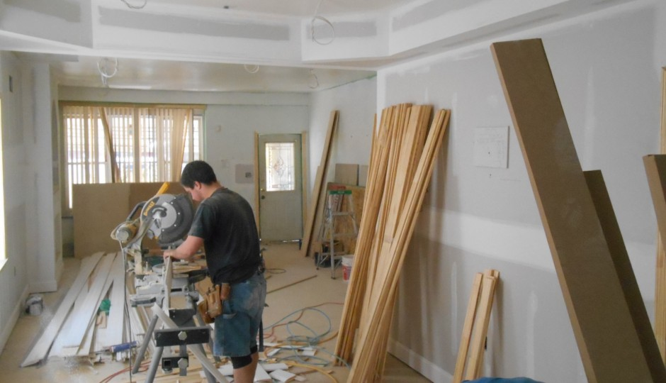 A man works inside a home on Boyer Street in Germantown | via Ken Weinstein