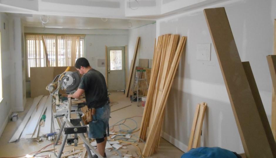 A man works inside a home on Boyer Street in Germantown | via Ken Weinstein