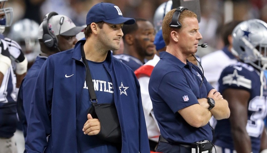 Tony Romo and Jason Garrett. (USA Today Sports)