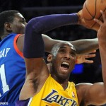 January 1, 2013; Los Angeles, CA, USA; Los Angeles Lakers shooting guard Kobe Bryant (24) grabs a rebound in front of Philadelphia 76ers point guard Jrue Holiday (11) in the second half of the game at the Staples Center. 76ers won 103-99.