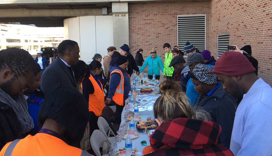 Workers at the Philadelphia International Airport pray for workers' rights before a Thanksgiving feast. They held a 24-hour fast to protest what they say are low wages and unfair treatment from management.