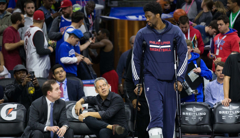 Sixers center Joel Embiid talks to general manager Sam Hinkie before a game earlier this season | Bill Streicher-USA TODAY Sports