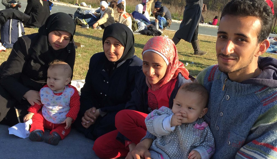 25-year-old Zachariah Kwirah (right), a factory worker from Syria, said he was almost separated from his family of three babies, two sisters and mother-in-law at a Serbian processing camp. Issue date: Monday November 16, 2015. Photo credit should read: Michael McHugh/PA Wire