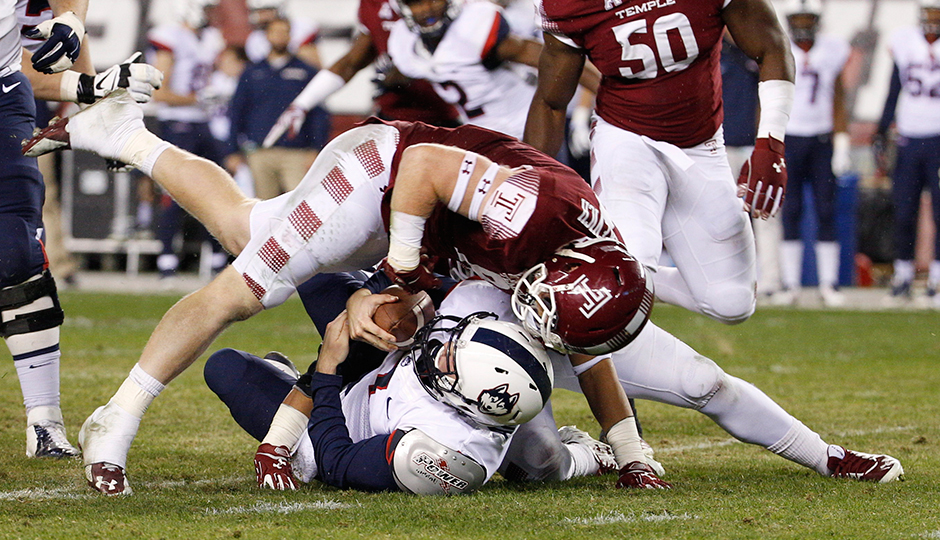 Temple linebacker Tyler Matakevich (8) sacks Connecticut quarterback Garrett Anderson (7) during the first half of Saturday's Temple–UConn game. Photo by Chris Szagola/AP