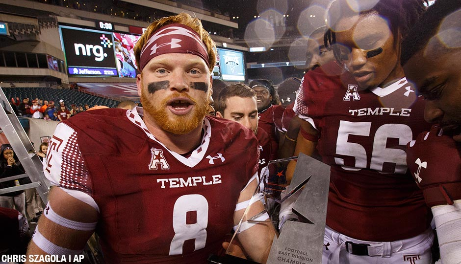 Temple linebacker Tyler Matakevich (8) holds the American Conference East Division Trophy following the second half of an NCAA college football game against Connecticut, Saturday, Nov. 28, 2015, in Philadelphia. Temple won 27-3.