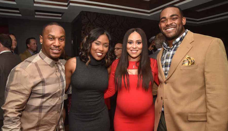 Eagles' Darren Sproles, Michel Sproles with Carlyne (who is due in February) and Brandon Graham.