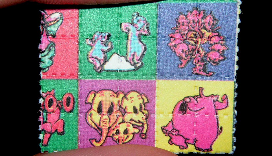 """Pink Elephants on Parade Blotter LSD Dumbo"" by Psychonaught - Own work. Licensed under Public Domain via Wikimedia Commons."