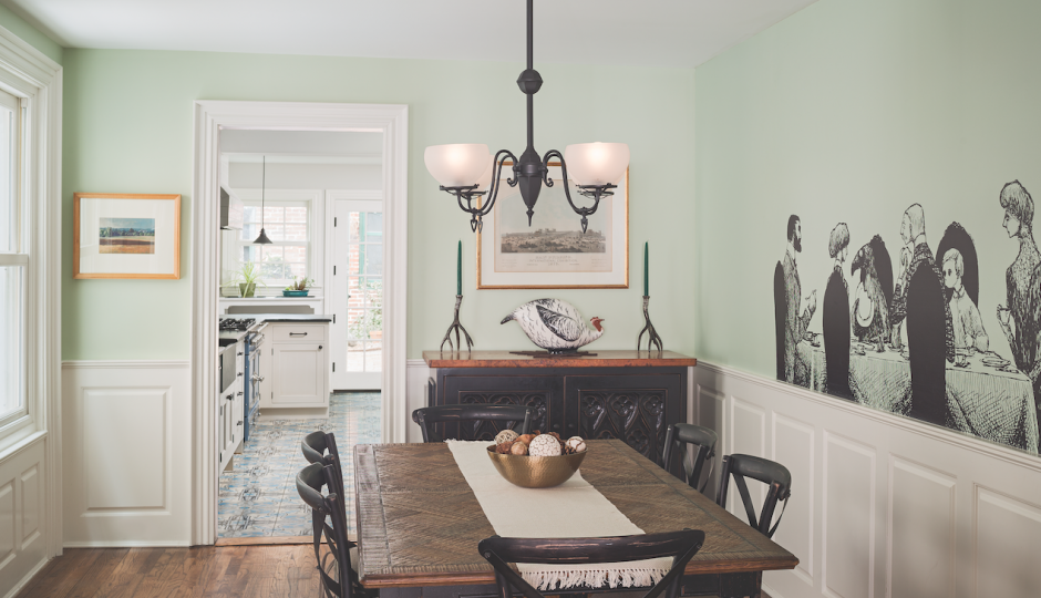 """A life-size illustration from Edward Gorey's The Doubtful Guest stands out in the redesigned dining room. """"It all plays into the Victorian aesthetic,"""" says Eban."""