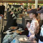 The Kitchen Twins sampling their kale chips at Whole Foods | Photo via Facebook