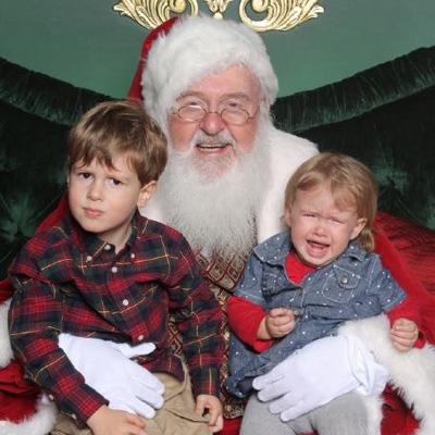 Fishtown Pharmacy owner Kris Hunsicker's kids posing with Santa.