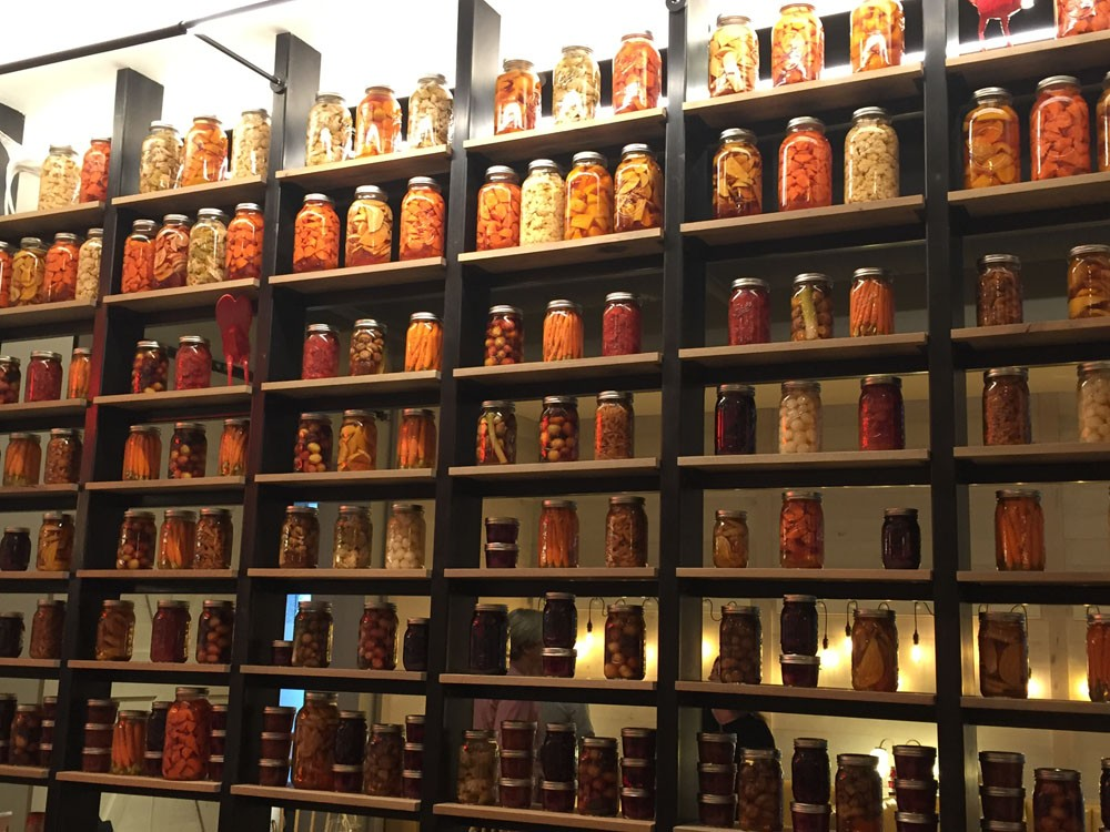 All the jars on this long wall are items pickled in house.