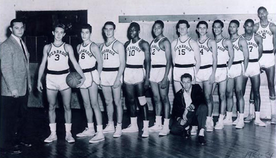 Coach Cecil Mosenson (far left) and Wilt Chamberlain (far right) in 1953 Overbrook High School basketball team photo.