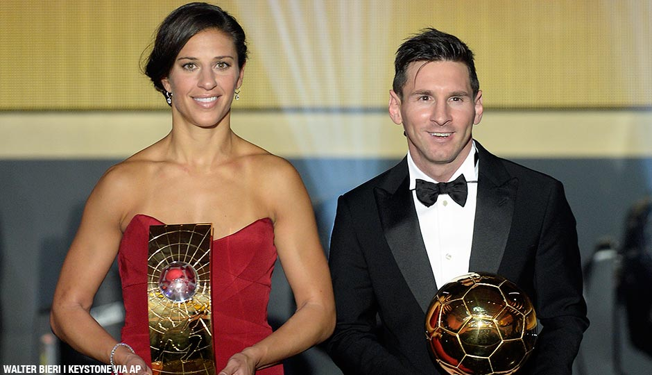 Carli Lloyd of the USA and Argentina's Lionel Messi pose with their trophies after winning the FIFA soccer player of the year 2015 prize during the FIFA Ballon d'Or awarding ceremony at the Kongresshaus in Zurich, Switzerland, Monday, January 11, 2016.