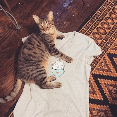 Beef putting his stamp of approval on the cafe's logo t-shirt.
