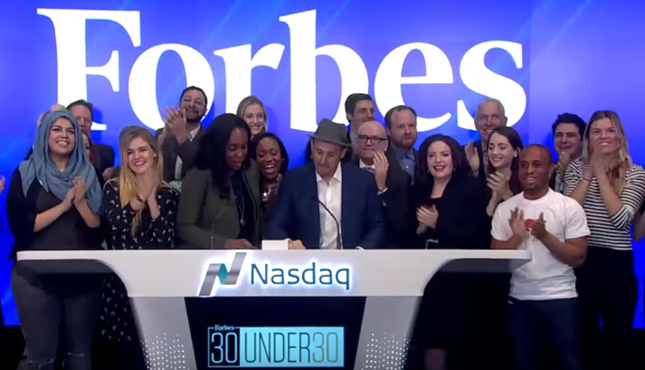 Christopher Gray (on the right in the white T-shirt) was among the Forbes Under 30 winners to ring the Nasdaq opening bell on Monday.