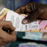 A person purchase Powerball lottery tickets from a newsstand Wednesday, Jan. 6, 2016, in Philadelphia. Players will have a chance Wednesday night at the biggest lottery prize in nearly a year.