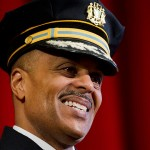 """Richard Ross smiles during his swearing in ceremony as Philadelphia's new police commissioner, Tuesday, Jan. 5, 2016, at his alma mater, Central High School, in Philadelphia. Ross said his top priority is reducing crime while improving community relations in what he called """"a challenging time for law enforcement."""""""