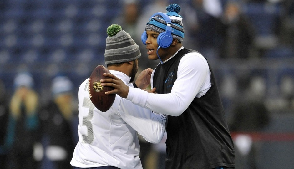 Russell Wilson and Cam Newton. (USA Today Sports)