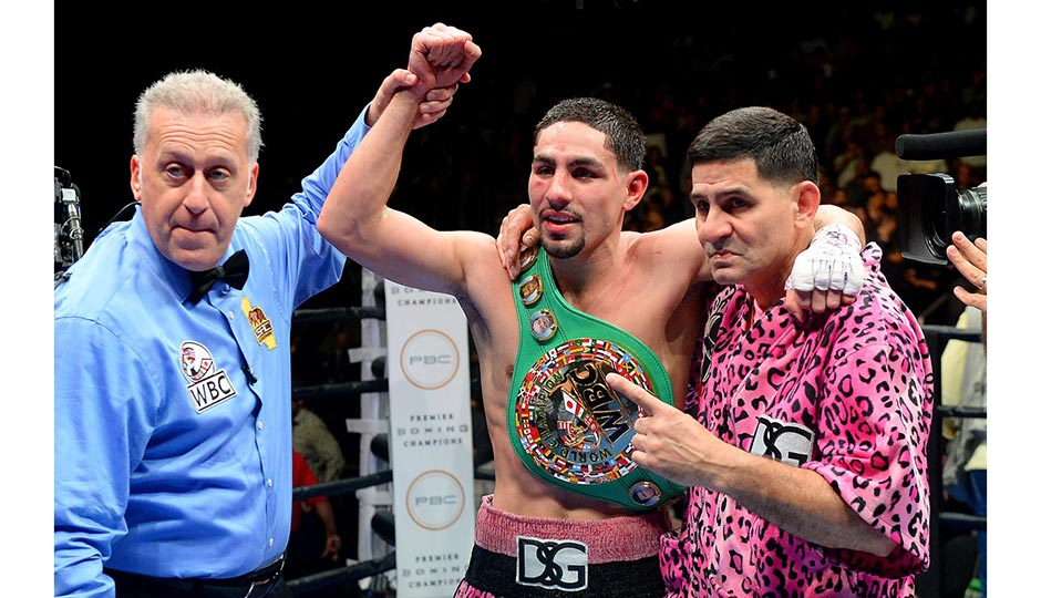 Jan 23, 2016; Los Angeles, CA, USA; Danny Garcia, pumps his fist after defeating Robert Guerrero (not pictured) during their WBC welterweight boxing title fight at Staples Center. Garcia won by decision. Photo | Jayne Kamin-Oncea-USA TODAY Sports
