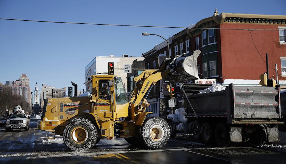 Crews remove snow along Broad Street after a winter storm, Sunday, Jan. 24, 2016, in Philadelphia. (AP Photo/Matt Slocum)