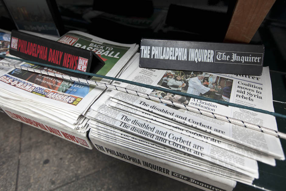 The Philadelphia Inquirer and Philadelphia Daily News newspapers sit on display on a newsstand in Philadelphia. (AP Photo/Matt Rourke)