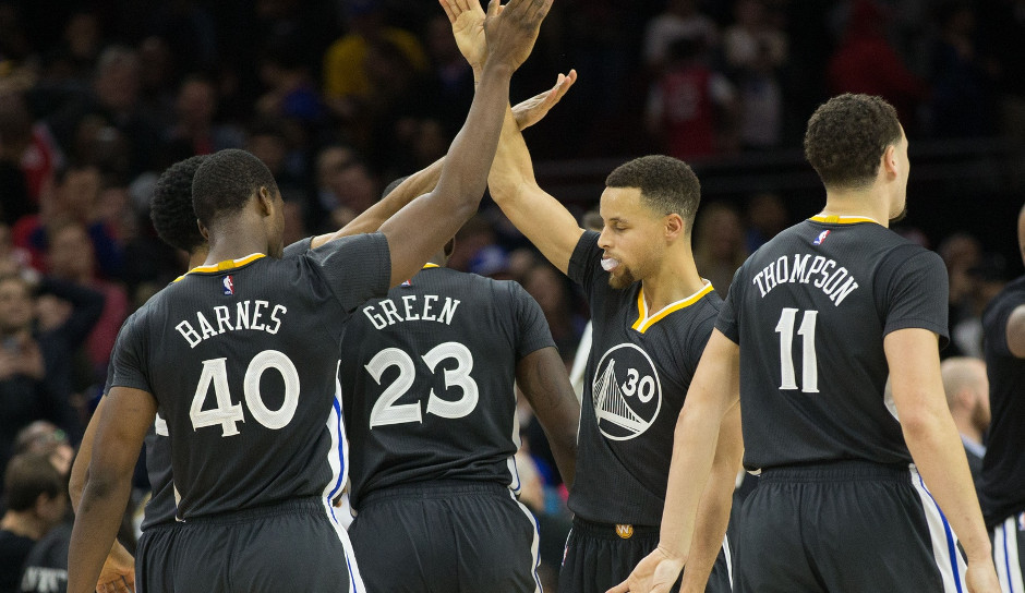 Golden State Warriors forward Harrison Barnes (40) is congratulated after hitting the game winning shot against the Philadelphia 76ers at Wells Fargo Center. 108-105 | Bill Streicher-USA TODAY Sports