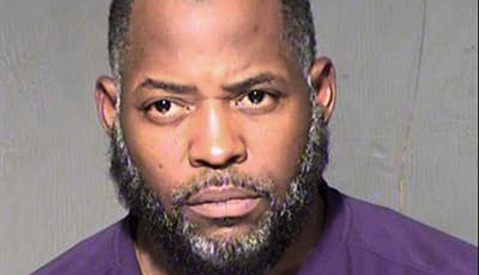 FILE - This undated file law enforcement booking photo from the Maricopa County, Ariz., Sheriff's Department shows Abdul Malik Abdul Kareem. As federal prosecutors in Phoenix investigate whether more people might be involved, the case against 43-year-old Abdul Malik Abdul Kareem provides a window into how Kareem, Elton Simpson and Nadir Soofi planned to attack major events, including the cartoon contest in Texas where Simpson and Soofi were killed by police May 3. The story is one of Arizona's Top 10 stories for 2015.(Maricopa County Sheriff's Department via AP, File)