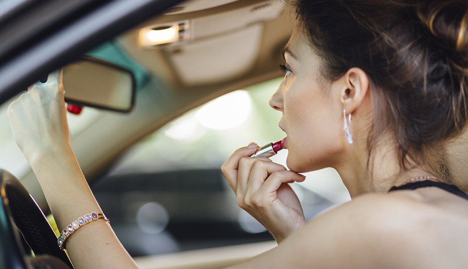 Because sometimes you just have to touch up your lipstick at a red light. | iStockPhoto.com/ArthurHidden.