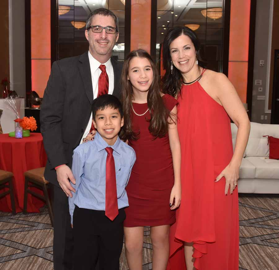 Phyllis and Darren Sudman, founders of Simon's Fund, with their children Jaden and Sally.