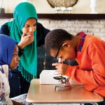 Ameenah Muhammad-Diggins guides daughter Amaya and son Anwar through a science lesson. | Photograph by Scott Lewis