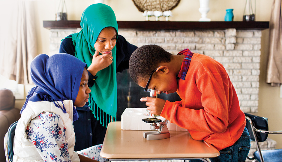 Ameenah Muhammad-Diggins guides daughter Amaya and son Anwar through a science lesson.   Photograph by Scott Lewis
