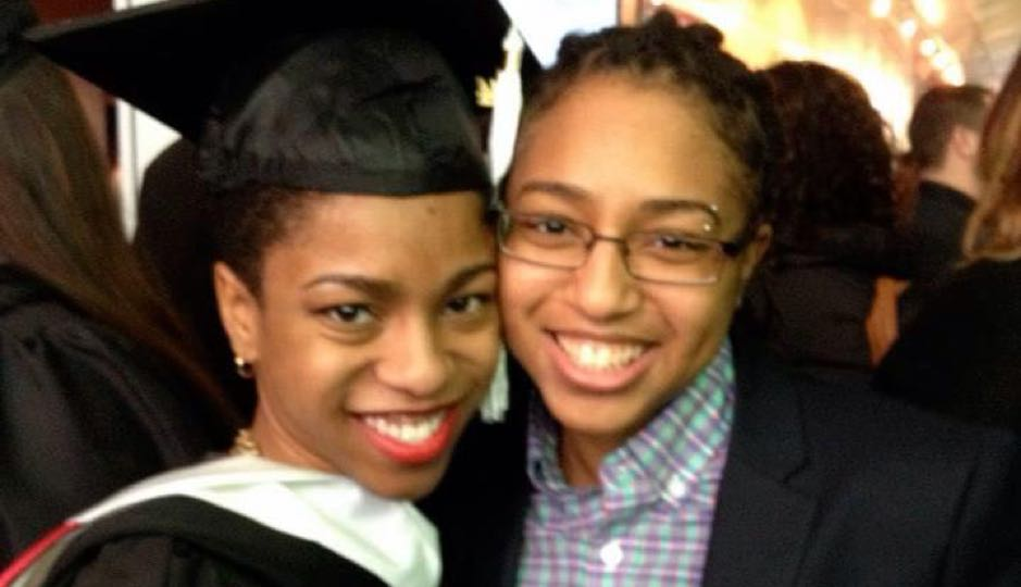Asha (left) with her partner Tez at her college graduation.