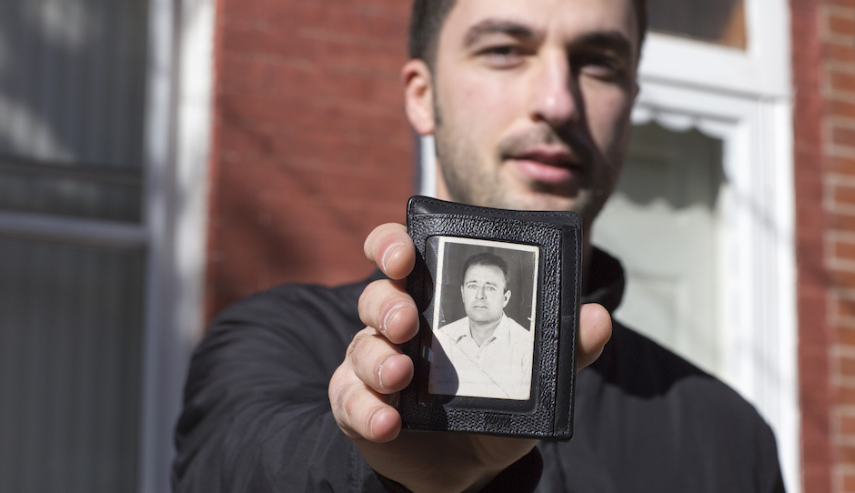 Hakan Ibisi carries a photograph of his grandfather in his wallet. Ibisi was photographed for the Philly Block Project, a collaboration between the Philadelphia Photo Arts Center and Hank Willis Thomas. Photo by Wyatt Gallery/Hank Willis Thomas Studio.