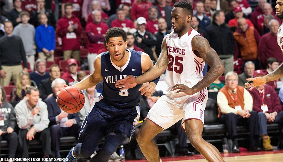 Villanova Wildcats guard Josh Hart (3) dribbles past Temple Owls guard Quenton DeCosey (25) during the first half at Liacouras Center on February 17th.