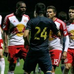 New York Red Bulls defender Ronald Zubar (23) and midfielder Sal Zizzo (15) exchanges words with Philadelphia Union midfielder Ilsinho (24) as he gets called for a red card on New York Red Bulls defender Gideon Baah (3) during the first half at Joe DiMaggio Sports Complex.