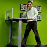 Vynamic CEO Dan Calista on a walking treadmill desk.