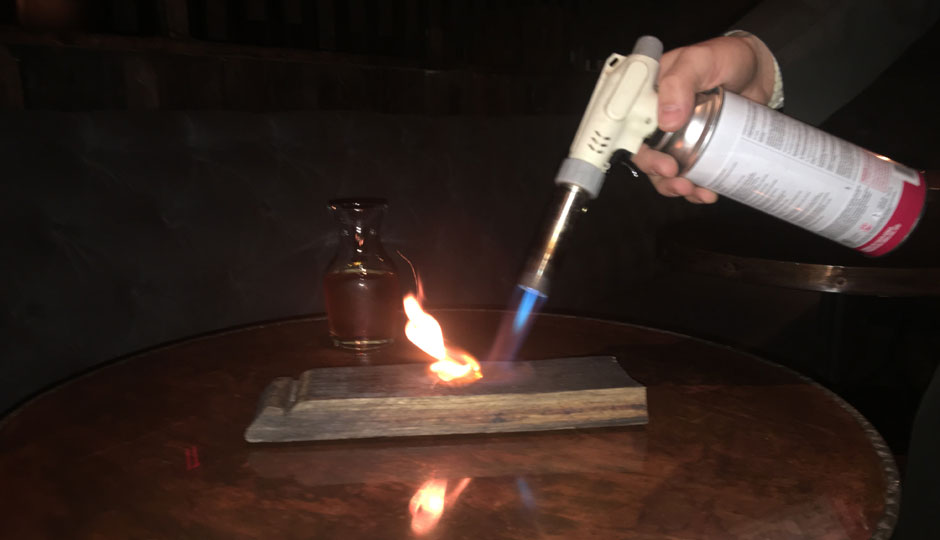 Torching the cinnamon and clove.