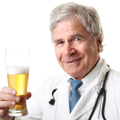Ridiculous doctor with beer AleksandarNakic / iStock