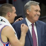 Sixers rookie point guard T.J. McConnell and associate head coach Mike D'Antoni react during a timeout | Bill Streicher-USA TODAY Sports