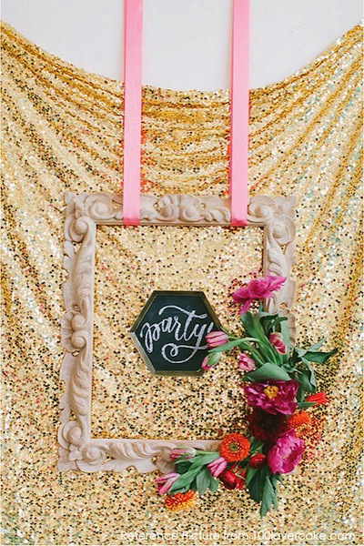 Gold sparkly backdrop: check.